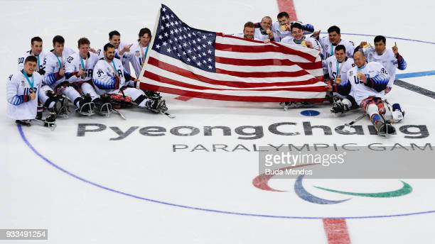 The team United States celebrate winning the gold medal over Canada in the Ice Hockey gold medal game between Canada and United States during day...