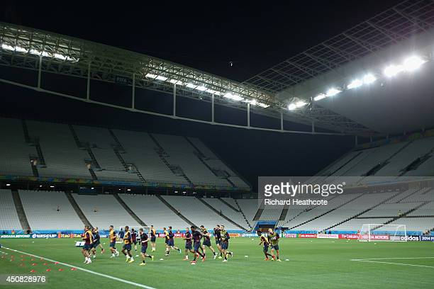 The team warm up during the England training session at the Arena de Sao Paulo on June 18 2014 in Sao Paulo Brazil