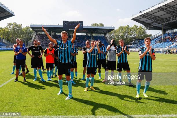 The team with Maurice Deville of Waldhof Mannheim celebrates the victory during the 3. Liga match between SV Waldhof Mannheim and MSV Duisburg at...