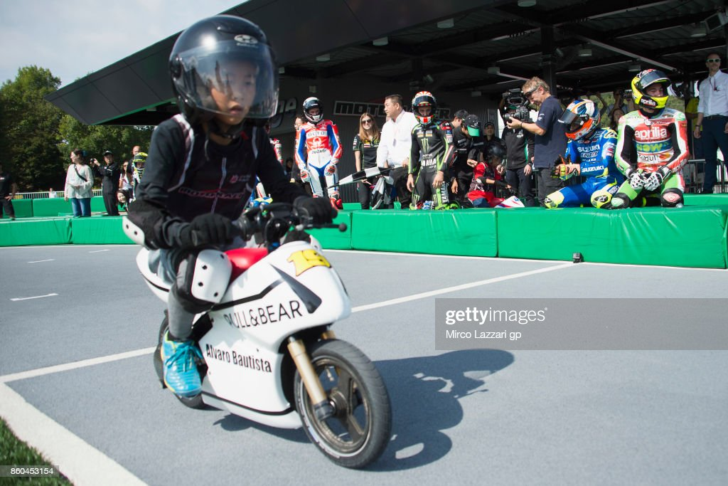 The teammate (for this pre-event race) of Alvaro Bautista of Spain and Pull&Bear Aspar Team rides the mini-bike during the pre-event 'The mini-battle between the MotoGP riders and children with electric mini bikes at Mobi Park at Motegi' ahead of the MotoGP of Japan at Twin Ring Motegi on October 12, 2017 in Motegi, Japan.