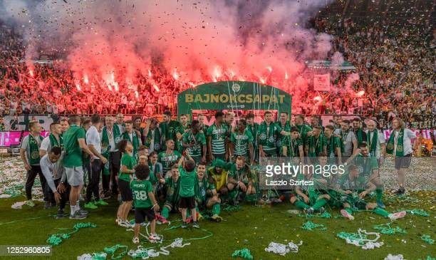 The teammates of Ferencvarosi TC celebrate the 31st championship title in front of ultras after the Hungarian OTP Bank Liga match between...