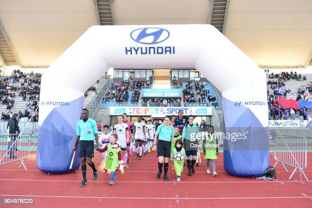 The teams come out for the Division 1 match between Paris FC and Lyon on January 14 2018 in Evry Bondoufle France