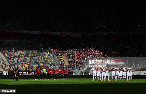 The teams commemorate the victims of the terrorist attack in Barcelona before the beginning of the German Second Bundesliga soccer match between...