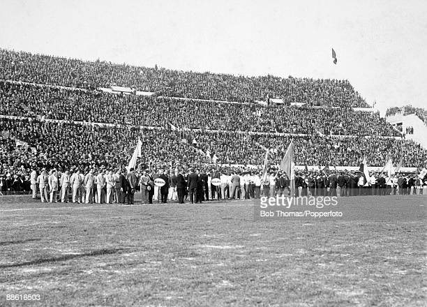 The teams competing in the first FIFA World Cup tournament parade around the Estadio Centenario in Montevideo as the Stadium is officially opened...