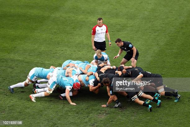 The teams contest a scrum during the preseason match between Saracens and Ospreys at the Honourable Artillery Company on August 23 2018 in London...