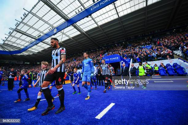 The teams emerge from the tunnel for the Premier League Match between Leicester City and Newcastle United at The King Power Stadium on April 7 in...