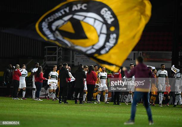 The teams enter the pitch before The Emirates FA Cup Second Round Replay between Newport County and Plymouth Argyle at Rodney Parade on December 21,...