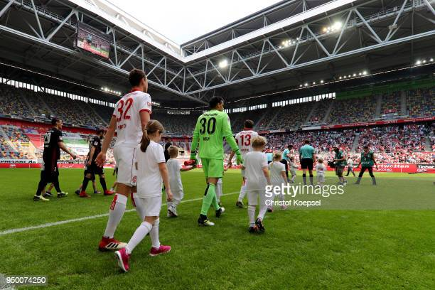 The teams enter the pitch during the Second Bundesliga match between Fortuna Duesseldorf and FC Ingolstadt 04 at EspritArena on April 22 2018 in...