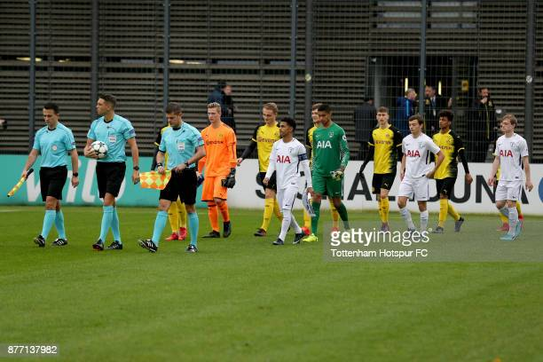 The teams enter the pitch prior to the UEFA Youth League match between Borussia Dortmund and Tottenham Hotspur at Training Ground Brakel on November...