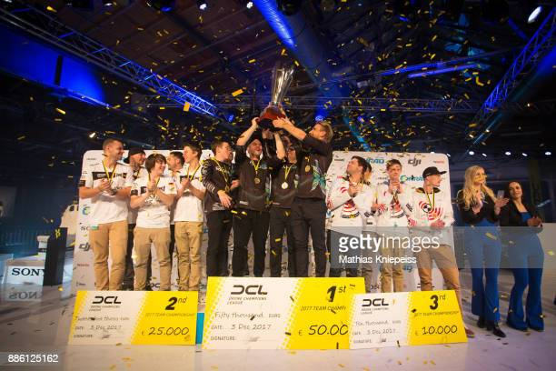 The teams FlyDurino Nexxtblades and Rotorama are celebrating on stage at Station Berlin during the DCL Drone Champions League Championship Finals in...