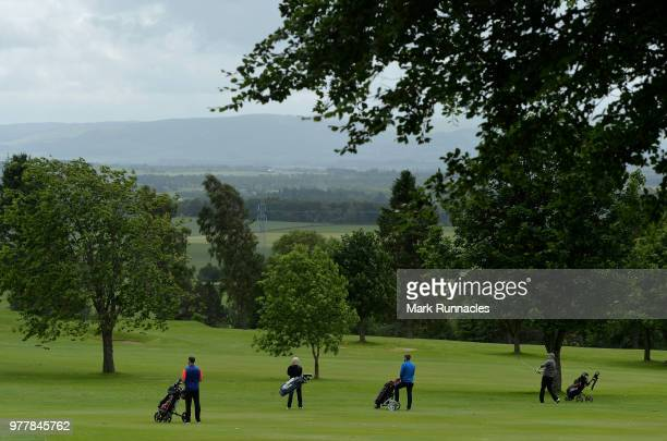 The teams from East Renfrewshire GC and Dunblane New Golf Course walk together at the 11th hole during the Lombard Trophy Scottish Qualifier at...