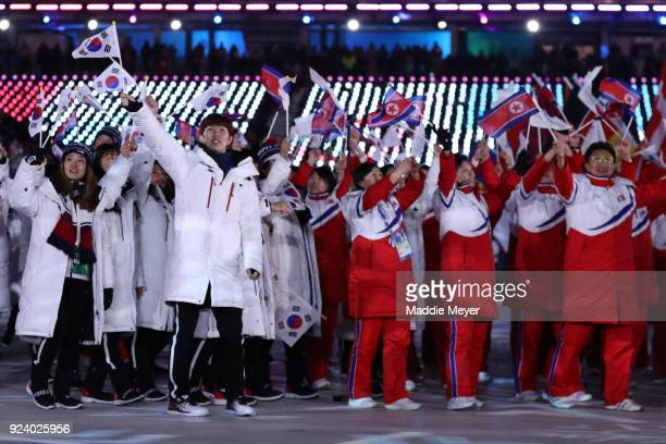 The teams from North Korea and South Korea walk together in the Parade of Athletes during the Closing Ceremony of the PyeongChang 2018 Winter Olympic...