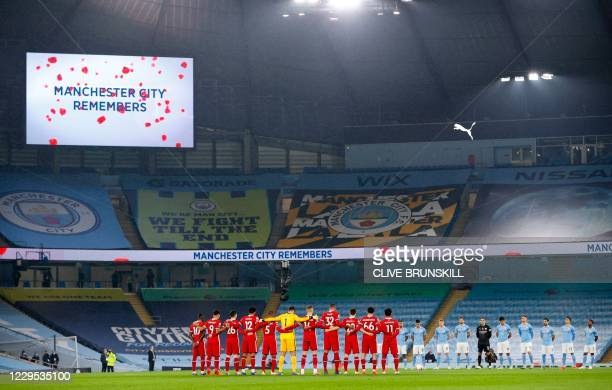 The teams gather around the centre circle for a silence for Remembrance Day ahead of kick off of the English Premier League football match between...