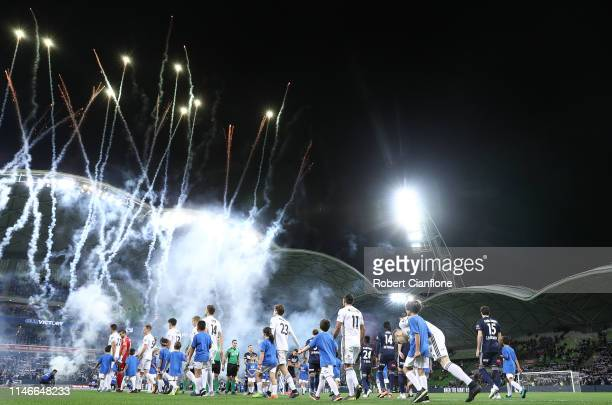 The teams head out during the ALeague Elimination Final match between Melbourne Victory and the Wellington Phoenix at AAMI Park on May 03 2019 in...