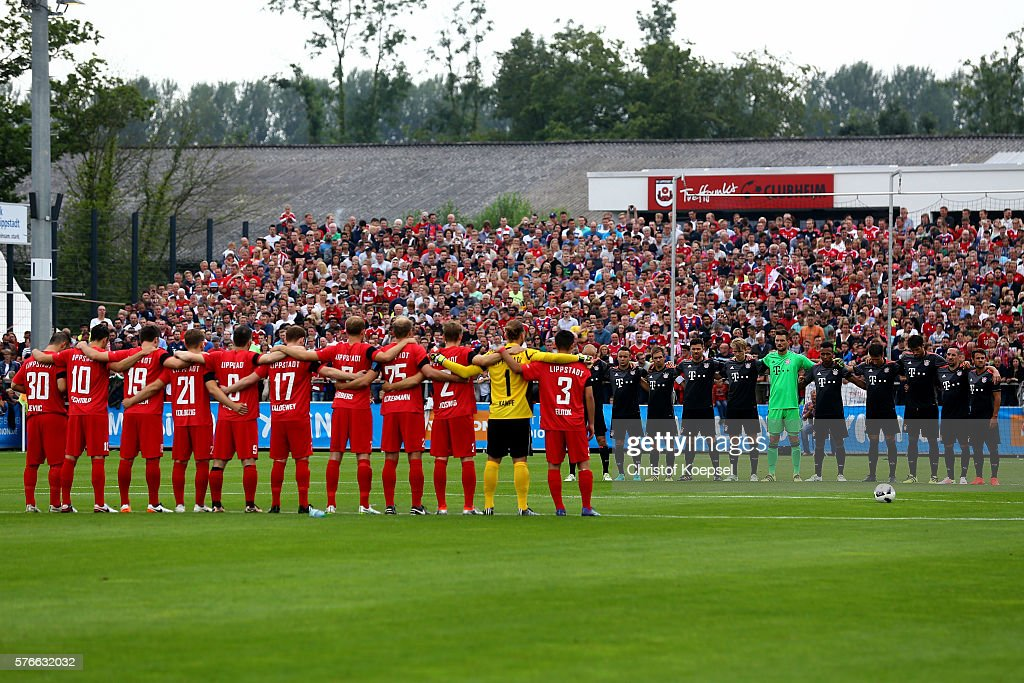 The teams hold a minute's silence during the friendly match between SV Lippstadt and FC Bayern at Stadion am Bruchbaum on July 16, 2016 in Lippstadt, Germany. The match between Lippstadt and Baern ended 3-4.