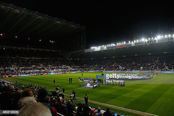 The teams lin up during the Barclays Premier League match between Newcastle United and Everton at St James' Park on March 25 2014 in Newcastle upon...