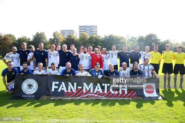 The teams line up after a fan match between teams from Germany and France at Bezirkssportanlage Bauernfeindstrasse on September 6 2018 in Munich...