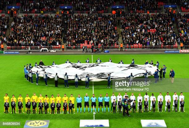 The teams line up ahead of the UEFA Champions League group H match between Tottenham Hotspur and Borussia Dortmund at Wembley Stadium on September 13...