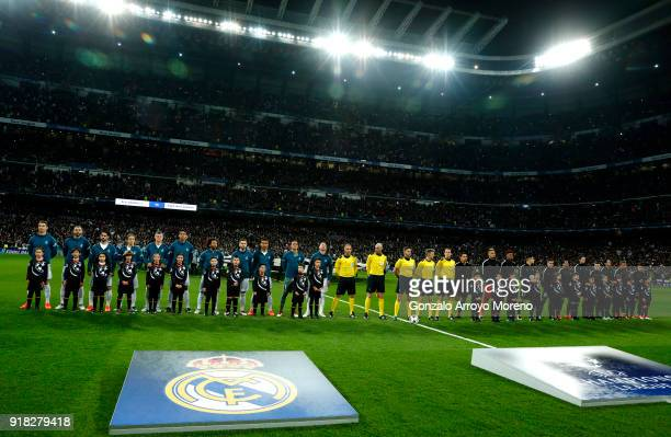 The teams line up ahead of the UEFA Champions League Round of 16 First Leg match between Real Madrid and Paris SaintGermain at Bernabeu on February...