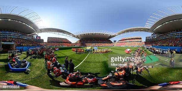 The teams line up before the 2014 FIFA World Cup Brazil Group B match between Netherlands v Chile at Arena de Sao Paulo on June 23 2014 in Sao Paulo...