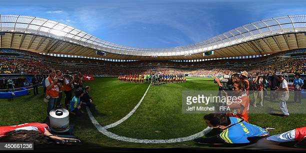 The teams line up before the 2014 FIFA World Cup Brazil Group E match between Switzerland v Ecuador at Estadio Nacional on June 15, 2014 in Brasilia,...