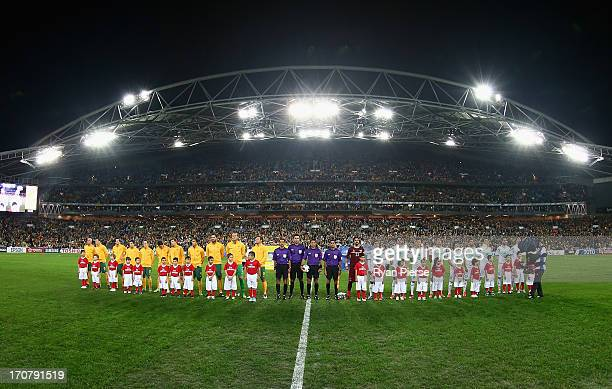 The teams line up before the FIFA 2014 World Cup Asian Qualifier match between the Australian Socceroos and Iraq at ANZ Stadium on June 18 2013 in...