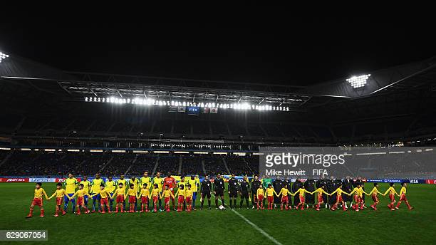 The teams line up during the FIFA Club World Cup second round match between Mamelodi Sundowns and Kashima Antlers at Suita City Football Stadium on...