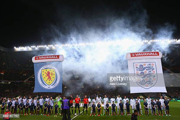 The teams line up during the International Friendly between Scotland and England at Celtic Park Stadium on November 18 2014 in Glasgow Scotland