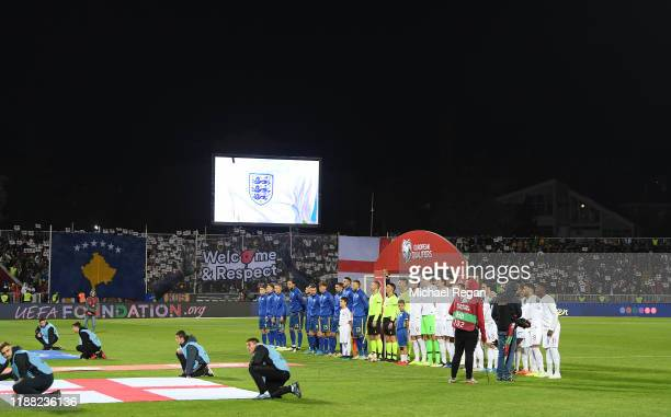 The teams line up for the anthems during the UEFA Euro 2020 Qualifier between Kosovo and England at the Pristina City Stadium on November 17 2019 in...