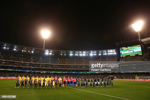 The teams line up for the Brasil Global Tour match between Australian Socceroos and Brazil at Melbourne Cricket Ground on June 13 2017 in Melbourne...