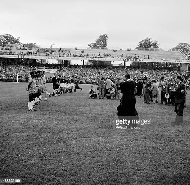 The teams line up for the national anthem before the World Cup football 1954 quarter final match between Brazil and Hungary at the Wankdorf Stadium...