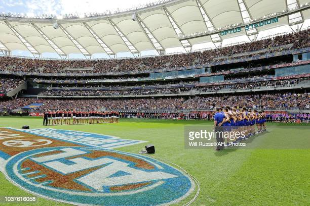 The teams line up for the National Anthem during the AFL Prelimary Final match between the West Coast Eagles and the Melbourne Demons on September 22...