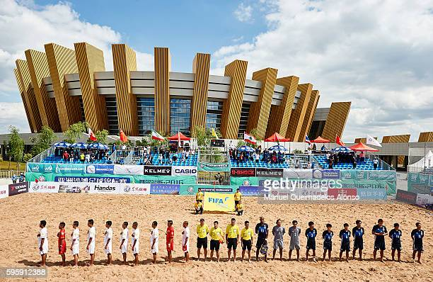 The teams line up for the national anthems before the Continental Beach Soccer Tournament match between Japan and Vietnam at Municipal Sports Center...