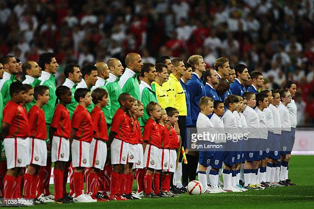 The teams line up for the national anthems before the UEFA EURO 2012 Group G Qualifying match between England and Bulgaria at Wembley Stadium on...
