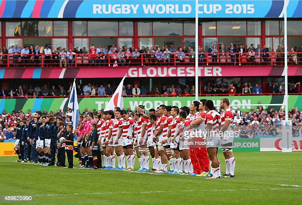 The teams line up for the national anthems during the 2015 Rugby World Cup Pool B match between Scotland and Japan at Kingsholm Stadium on September...