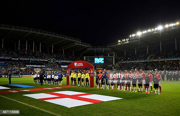 The teams line up for the national anthems prior to kickoff during the EURO 2016 Qualifier match between Estonia and England at A Le Coq Arena on...