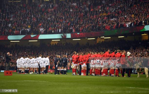 The teams line up for the National Anthems prior to the Guiness Six Nations match between Wales and England at the Principality Stadium on February...