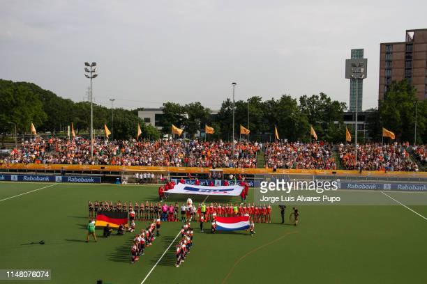The teams line up for the national anthems prior to the Women's FIH Field Hockey Pro League match between Netherlands and Germany at HC OranjeRood on...