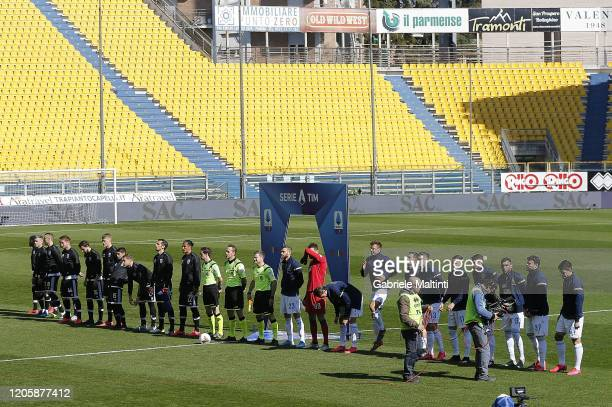 The teams line up in front of an empty stadium ahead of the Serie A match between Parma Calcio and SPAL at Stadio Ennio Tardini on March 8 2020 in...