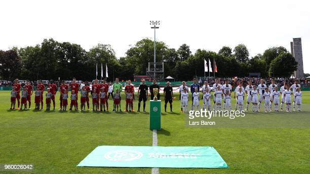 The teams line up prior to the DFB Juniors Cup Final 2018 between 1 FC Kaiserslautern U19 and SC Freiburg U19 at Stadion am Wurfplatz on May 19 2018...