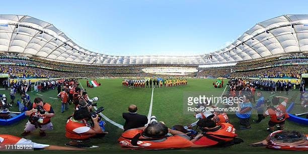 The teams line up prior to the FIFA Confederations Cup Brazil 2013 Group A match between Italy and Brazil at Estadio Octavio Mangabeira on June 22...