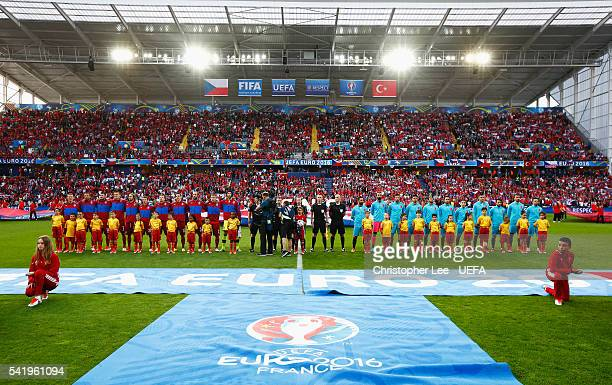 The teams line up prior to the UEFA EURO 2016 Group D match between Czech Republic and Turkey at Stade BollaertDelelis on June 21 2016 in Lens France