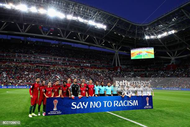 The teams lineup with an anti racism banner before the FIFA Confederations Cup Russia 2017 SemiFinal between Portugal and Chile at Kazan Arena on...