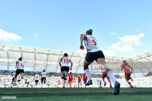 The teams make their way onto the field during the Rugby Sevens Women's Bronze Medal match between Canada and England on day 11 of the Gold Coast...