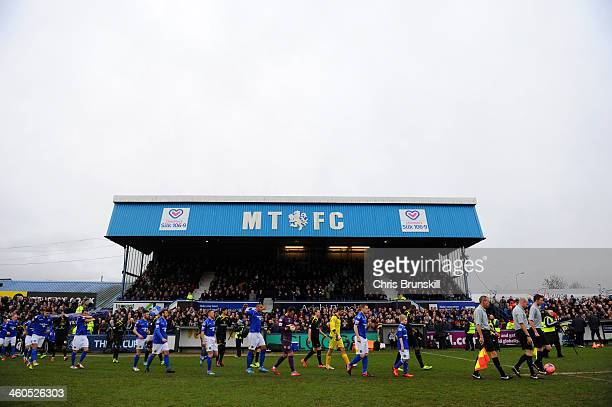 The teams make their way out onto the pitch for the Budweiser FA Cup Third Round match between Macclesfield Town and Sheffield Wednesday at Moss Rose...