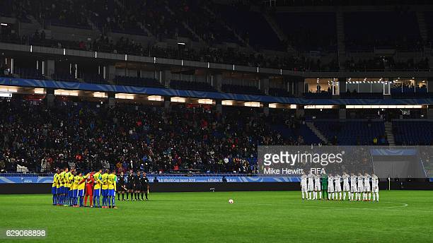 The teams observe a minutes silence for the victims of the plane crash involving the Brazilian club Chapecoense during the FIFA Club World Cup second...