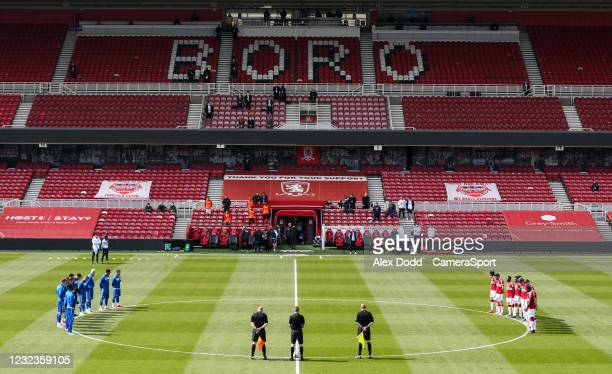 The teams observe a minutes silence in remembrance of HRH Prince Philip during the Sky Bet Championship match between Middlesbrough and Queens Park...