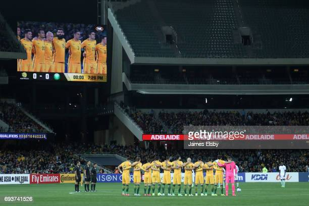 The teams observe a minute's silence to honour those lost in the recent terrorist attacks during the 2018 FIFA World Cup Qualifier match between the...