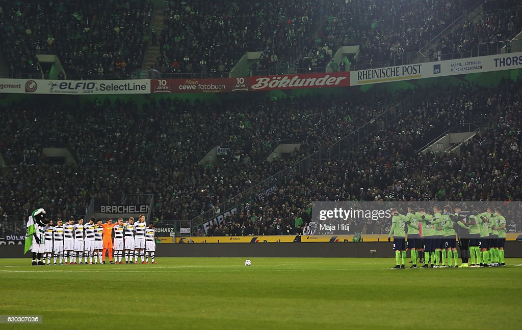 The teams observe a minute's silence to remember the victims of the Berlin attack prior to the Bundesliga match between Borussia Moenchengladbach and VfL Wolfsburg at Borussia-Park on December 20, 2016 in Moenchengladbach, Germany.