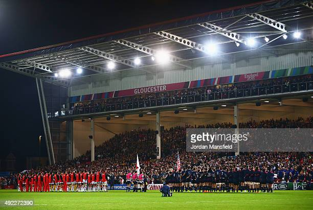 The teams observe the USA national anthem during the 2015 Rugby World Cup Pool B match between USA and Japan at Kingsholm Stadium on October 11 2015...